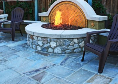 Fire pit and chairs next to it